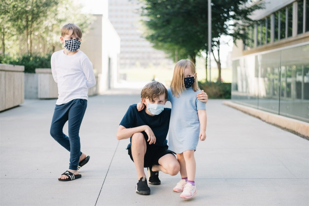 Three siblings together try to help a child with autism