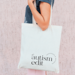 Woman carries with The Autism Edit logo bag over shoulder