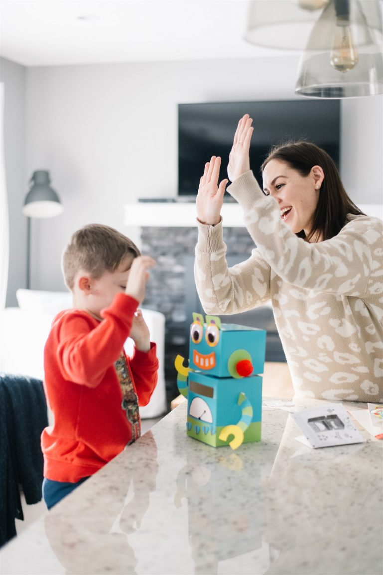 Mother plays with autistic son as a form of speech therapy